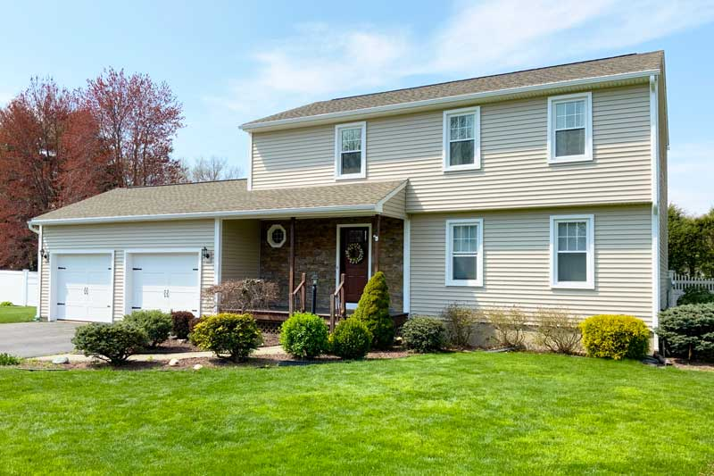 Project in Agawam, MA - roofing, siding, windows, entry door, stone & gutters